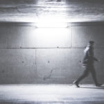man-walking-through-concrete-underpass-picjumbo-com